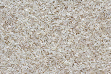uncooked: Asian white rice. Uncooked white rice background Stock Photo