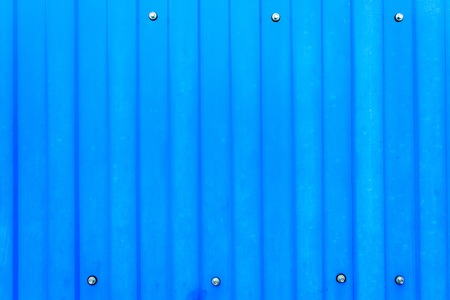 metal wall: Steel metal wall background with vertical ridges painted in blue color Stock Photo