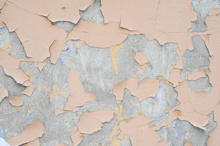 Cracked paint on old wall background of texture