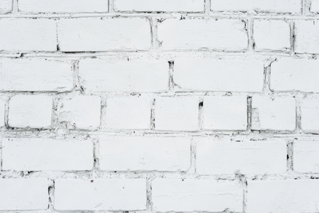 Old vintage dirty white brick wall for background or texture Stock Photo