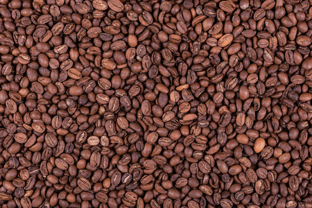 Roasted arabica coffee beans background or texture