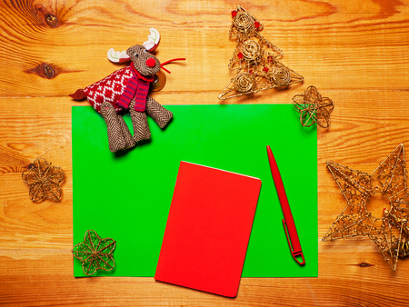 red pen: The blank sheet of paper on a wooden background with a red pen Stock Photo