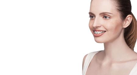 beautiful smile: happy beautiful girl with braces on white background - isolated