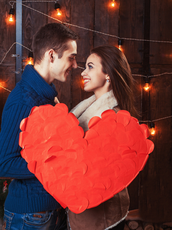 blue romance: happy couple holding red heart Stock Photo