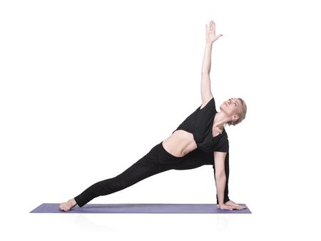 side angle pose: Beautiful young woman doing yoga asana - elongated side angle pose Stock Photo