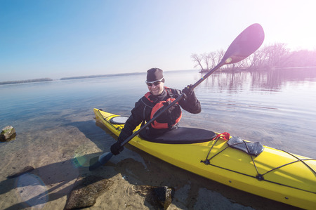 kayaker: journey in the winter and spring of the water Stock Photo