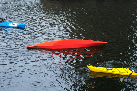 kayaker: kayaker performs float-assisted roll, eskemo roll, kayaking