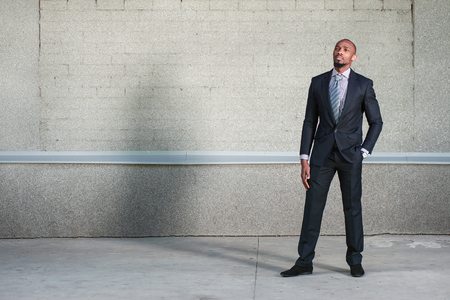 american banker: African American business man standing with a serious face