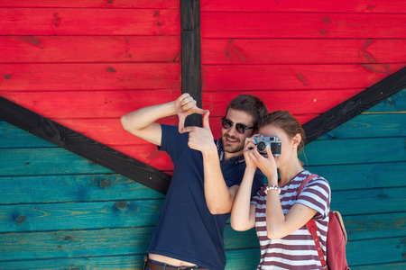 oncept: tourists funny couple taking a photo while walking in a city Stock Photo