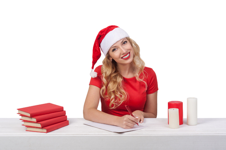 snug: christmas beautiful blonde girl with pen, thoughtful writes a letter, isolated on white background
