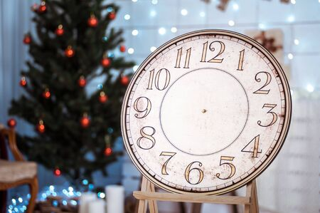 specify: vintage clock with an arrow in the room with the Christmas tree, dial without arrows Stock Photo