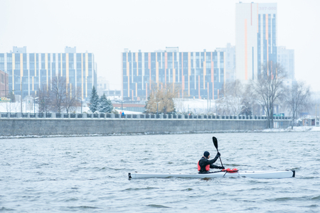 man kayaking on a winter river, extreme sports Stock Photo