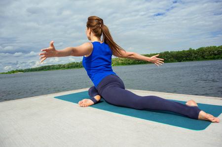 buena postura: Young woman doing yoga exercise on mat 05