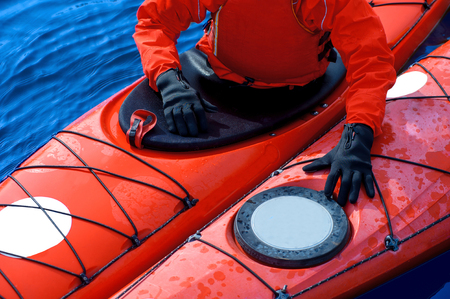 man in winter sportswear in a kayak