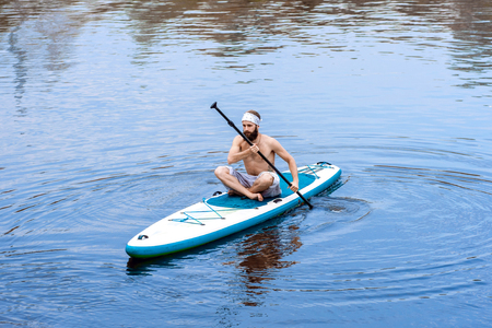 stand up paddle board beach man doing paddle board going paddle boarding
