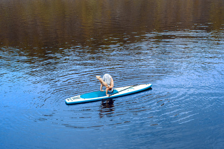 paddles: man practicing yoga doing paddle board going paddle boarding