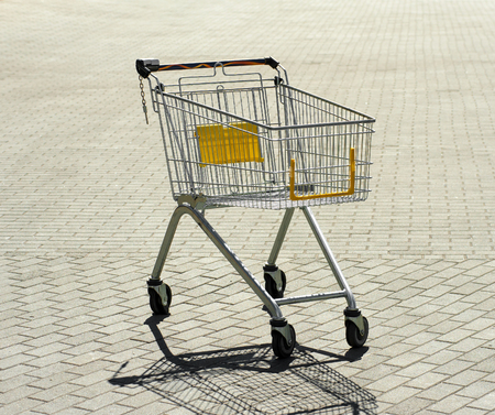 storehouse: an empty hypermarket cart stands alone outside