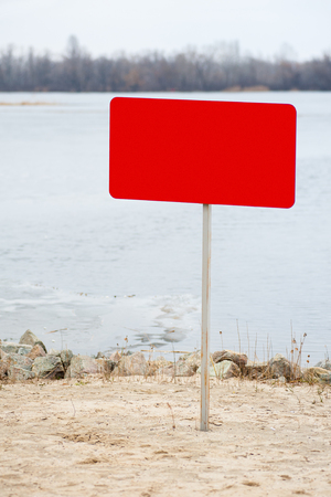 on the beach there is a prohibitory sign, an empty sign for the text
