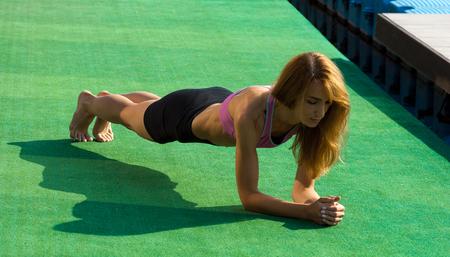 very slender girl doing warm-up before training