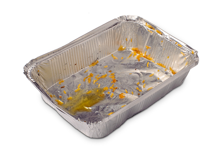 Take away disposable one-time plate with food leftovers on white background