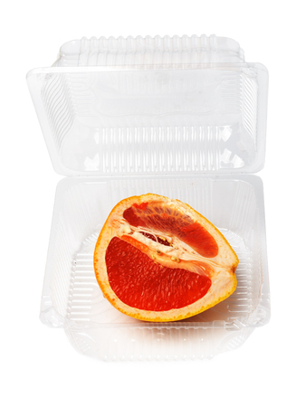 Half dry bright orange red fruit on isolated white background