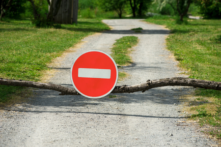 No entry sign in forest path representing environmental protection Stock Photo