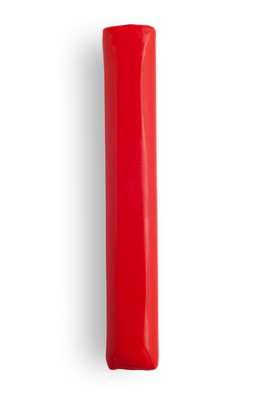 red piece of color plasticine on white background isolated