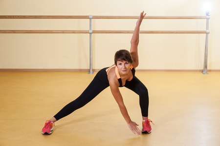 Young woman spending time on aerobics training