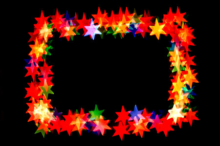 colorful stars form a frame.bokeh stars isolated on black background.frame of stars.
