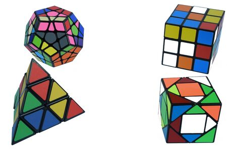 Four different 3d multi-colored cubes on a white background