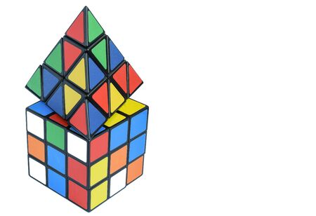 Two different 3d multi-colored cubes on a white background