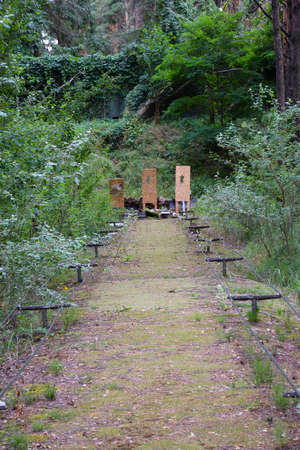 Shooting range in a summer forest under the open sky with targets in the background