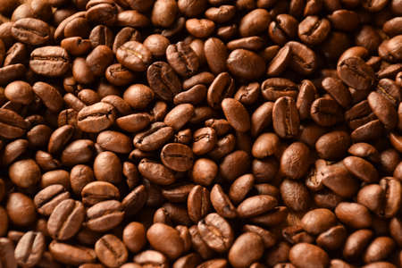 The whole background is covered with large coffee beans