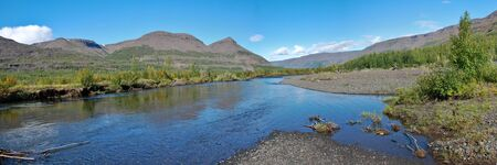 Panorama of the mountains on the banks of the river
