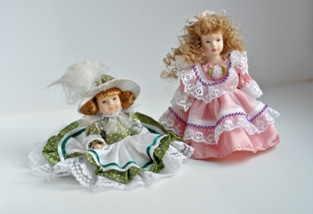 Doll dressed girls. The decor to the mantelpiece.