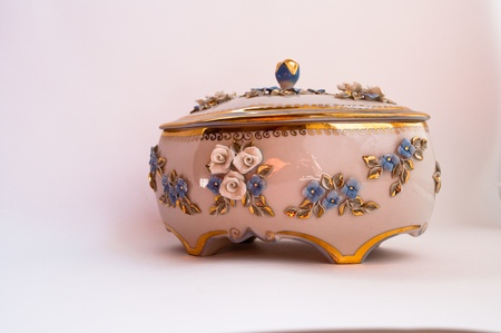 Decorations for the sideboard. Porcelain box on a white background Stock Photo