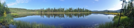 A panorama of lake mountains in the background, Suntar-khayata in Yakutia. District of Oymyakon highlands.