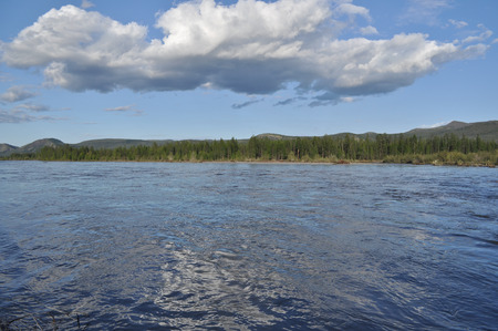 Water summer landscape surrounding the river Suntar in the Highlands of Oymyakon, Yakutia, Russia. Stock Photo