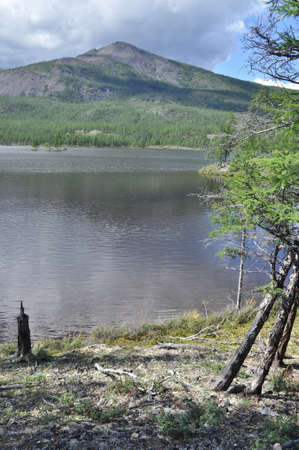 Eastern Yakutia  Summer landscape with a lake and mountains along the banks  Stock Photo