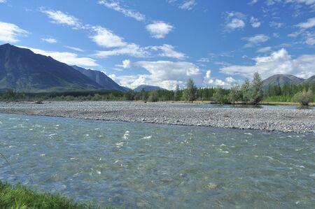 River flowing in a mountain valley. Landscape wildlife. Russia, Yakutia, a ridge of Suntar-khayata.