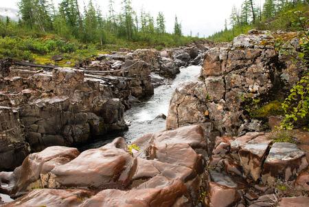 Rocky canyon of the mountain river. Russia, Taimyr Peninsula, Putorana plateau.
