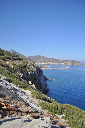 The Greek island of Crete is situated in the Mediterranean sea  Rocky shore of the sea  Stock Photo