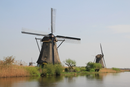 The Dutch windmill  Dutch countryside landscape with the windmill on the Bank of the canal