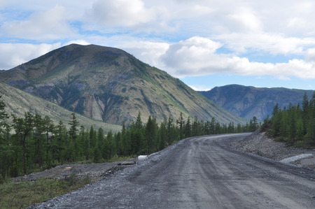 Highway in the mountains of Yakutia. The Federal highway Kolyma Yakutsk-Magadan, Yakutia, Russia. photo