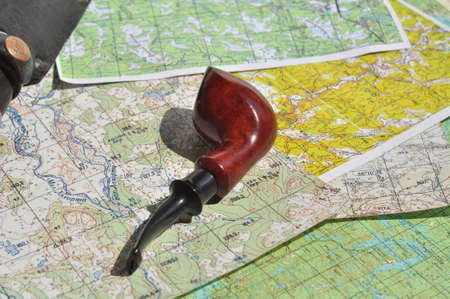indispensable: Map and Smoking pipe  The indispensable accessories for travel and adventure