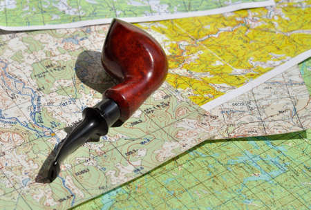 indispensable: Map and Smoking pipe. The indispensable accessories for travel and adventure.