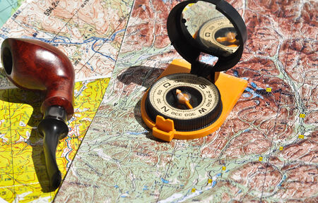 indispensable: Map, compass and pipe Smoking area. The indispensable accessories for travel and adventure.