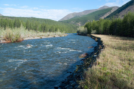Russia, Yakutia. The landscape of the mountain river clear summer morning.