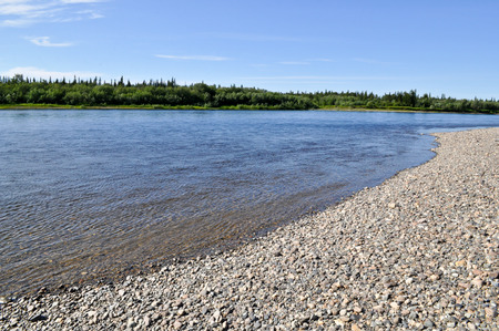 urals: Pebble beach North of the river. Summer landscape of one of the rivers of the Northern slope of the Polar Urals. Stock Photo