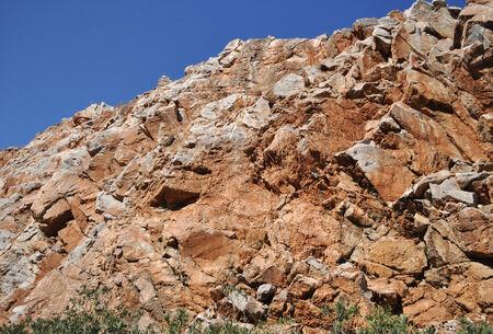 Red rocks on the island. Mediterranean sea, the island of Crete. Greece. Stock Photo